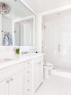 Timeless bath design... white bathroom without windows...still looks nice and bright.
