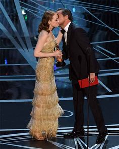"""Leonardo DiCaprio gives the Oscar for Best Actress to Emma Stone in """"La La Land"""" at the 89th Oscars on February 26, 2017 in Hollywood, California."""