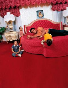 Ali-- Muhammed Ali with twin daughters Jamillah and Rasheda, and son Muhammad Jr.