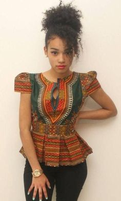 Our dashiki blouse has beautiful box pleated peplum and stunning cup sleeved design, with zipper closure at back. African Attire, African Wear, African Dress, Mode Wax, Afro Punk Fashion, African Fabric, African Prints, Ankara Peplum Tops, African Fashion Designers