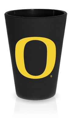 "SILIPINT Silicone Shot Glasses, Squishy Shot Glasses, The Original Unbreakable Shot Glass, Patented Unbreakable Glassware for Shots and Dips and More, Drinkware That is Heat Safe and Freeze Safe, Oregon Ducks Drinkware, Bouncy Black with ""O"" in Solid Yellow, 1.5-Ounce. Celebrate University of Oregon excellence on and off the gridiron with a Silipint silicone cup. A versatile durable insulated and environmentally friendly glassware replacement. A Green Oregon product that is BPA-free..."