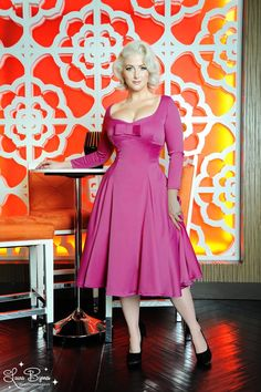 Sophia Dress in Baton Rouge Fuchsia Satin - Our Sophia Dress is a more modest version of our new Priscilla design with the same flattering cut and fit.  Made in luxurious Meredith satin, this style features longer sleeves, a beautiful full skirt, and a bow detail on the bodice.  The bust is lined in stretch charmeuse for comfort and structure and its finished off with a back zip.