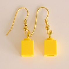 No instructions here but think it's simple to make or just purchase by clicking on the photo!  Yellow LEGO brick 1x1 on a Silver/Gold plated by MademoiselleAlma, $8.99