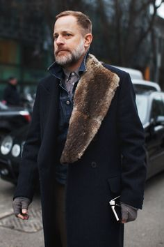 He's like the professorial hunting uncle I never had. He probably makes the best irish coffee in the world. He probably likes to fix strong drinks and read Hemingway aloud by a roaring fire on a bearskin rug he shot and skinned himself inside a cabin that he cut down the trees to build himself.