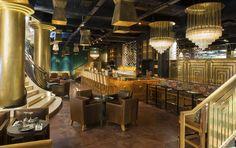 Beautiful designer luxury bar and restaurant Mango Paris,  design from Laura Gonzalez. Featured on Martyn White Designs interior design blog www.martynwhitedesigns.com.
