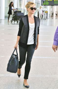 Reese Witherspoon kept it preppy and cool in a leather-detailed cardigan, cropped denim, and studded flats while arriving in Toronto.