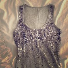 Express sequin tank XS Gray tank with sequins on the front. Back of tank is plain. Noticed one loose thread, pictured. Express Tops Tank Tops