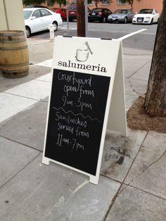 Salumeria Sidewalk sign, a 2' x 3' custom painted wood with screen printed logo and chalkboard.