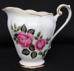 Vintage Staffordshire milk jug, perfect for flowers or milk!  The overblown floral design and gilt trim typical of the late 1950's