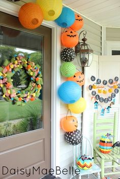 Happy Halloween Front Porch - like the paper lanterns mixed with the jack-o-lantern buckets (cute!)