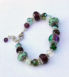 Purple and Green Lampwork Glass Adjustable Beaded Bracelet by goldcountrydangles on Etsy
