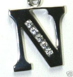 """14K White Gold CZ Belly Ring Initial """"N"""" (1.25"""" Length) Totalheaven. $165.00. Made in USA. Round Brilliant Cut Stones. Genuine Solid 14K Plumb Gold. AAA Machine Cut Cubic Zirconias. Gauge 14"""