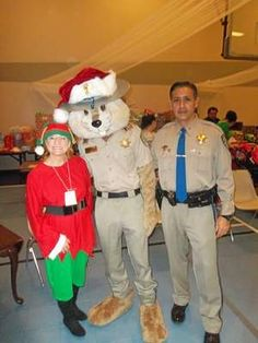 California Highway Patrol mascot Chipper poses with Jessie Woods, owner of The Gold Exchange, and Lt. Lou Aviles, commander of the Red Bluff Area CHP.