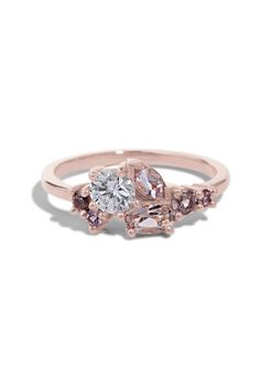 This custom Cluster Ring features an heirloom .38ct diamond set with 5x3mm oval morganite, 5x2.5mm marquise morganite and four 2mm - 2.5mm spinels set in a low prong style setting in polished 14kt rose gold.