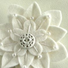 White on White Felt Flower Pin with Vintage White Button and Pearls and Hand Embroidery. by Dorothy Reinhardt on Etsy.