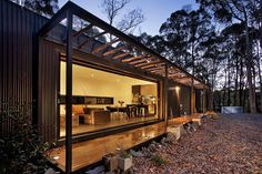 A large circle of dense bushland was cleared to give the illusion of botanical seclusion with the home positioned in a linear orientation across the centre of the clearing to provide a 360 degree panoramic view of pure landscape.Comprised of two modules with covered decking between and a pergola