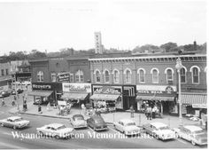 Description of . Biddle Avenue and Elm Street as it was during 1960. Businesses shown include Weaver's, Nunn—Bush Shoes, George Leathers Shoes, Brohl's Men's Wear, Art Allen and the Cahalan Building. Photo courtesy of Bacon Memorial District Library