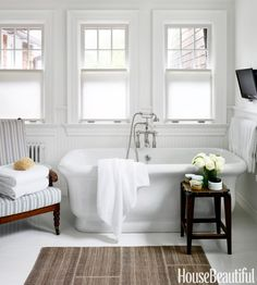 """Shaker Style Cottage - Robert Stilin n the master bathroom, Waterworks' empire tub is """"strong, soft , and welcoming,"""" Stilin says. Malabar's Jutis covers an English bobbin chair. A kilim from Tibetano warms the floor. Bathroom Interior, Home Interior, Interior Design, Bathroom Ideas, Bathroom Designs, Bathroom Goals, Bathroom Trends, Budget Bathroom, Bathroom Vanities"""