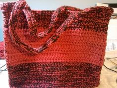 This crochet bag is the perfect beginner project.  If you want to move past a simple scarf and would like to try something a little different this bag is perfect for you.  Using 2 strands of contrasting yarn (your color choice) this bag is a good option for using your team colors, school colors, favorite colors etc.  It can also be made in a sol...