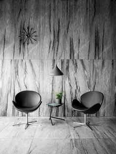 Ogi chair designed by Danish designer Anders Nørgaard for BoConcept. Gorgeous  marble wall and floor.