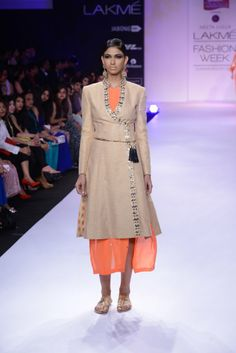 DAY 5: NEETA LULLA  Neeta Lulla showcases a beautiful collection with bold colors, ethnic inspired silhouettes while retailing an edge with her sharp tailoring.  Shop straight off the runway: http://www.perniaspopupshop.com/lakme-fashion-week/neeta-lulla #lakmefashionweek #lfw #2014 #neetalulla #amazing #straightofftherunway #perniaspopupshop #shopnow #spring/summer #resort #collection