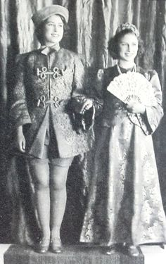 The young Princess Elizabeth dressed a man and Princess Margaret Rose as a maiden in a theatre performance. Description from got-blogger.com. I searched for this on bing.com/images