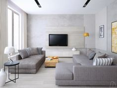 Simple is perfect in this cool grey living room with massive, deep sofas. They make you want to take a nap even when you're barely out of bed.