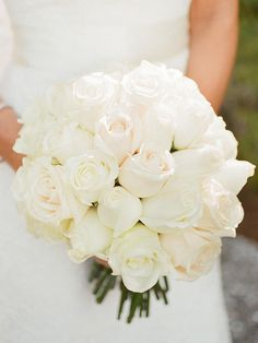 It doesn't get any more elegant than a classic all-white rose wedding bouquet.