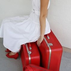 always wanted to wear red shoes and a white dress. the suitcases just complete it.