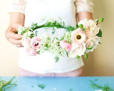 Kiana Underwood of Tulipina shares how to make a lovely pink and peach floral crown out of cilantro blooms, ranunculi, and garden roses. Photo by N. R. Underwood.
