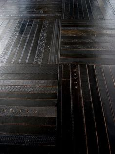 How to recycle old belts?   Making a new floor.  by Inghua Ting