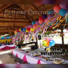Balloon decorations for Kids parties. Garland with ribbons as centerpiece. Superheroe girl theme. Superheroes Birthday party ideas. Gazebo balloon decor. Extreme Decorations PH: 786-663-8198 www.extremedecorations.com