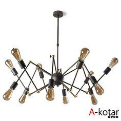 Lámpara de techo de diseño en color oscuro y con bombillas de ahorro energético.  #lampara #luz #decoracion #interiorismo