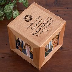 """This cube-shaped custom corporate logo picture frame is a unique corporate gift idea for your next employee giveaway, promotional event, or corporate outing.   The natural wood-grain gives it a classy touch which will look great on the desktops of your customers, employees, and executives.  Laser engraved with your name, title, text, and/or logo Measures 4½""""x4½"""" 4.25"""" x 4.25"""" imprint area Holds 4-3""""x3"""" photos"""