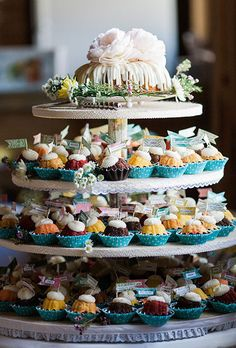 Brides: Four-Tiered Tower of Mini Bundt Cakes. A four-tiered tower filled with assorted miniature bundt cakes, in flavors like lemon, chocolate chip, and chocolate raspberry, created by Nothing Bundt Cakes. Dessert Bars, Dessert Bar Wedding, Wedding Desserts, Wedding Cakes With Cupcakes, Unique Wedding Cakes, Nontraditional Wedding, Rustic Wedding, Wedding Ideas, Wedding Vintage
