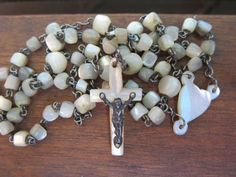 Small antique french rosary Delicate small hand cut beads of mother-of-pearl Small heart in the center that acts as medal Simple cross with metal Jesus  Approx 30  In good condition  Size : 14 in - 36 cm Weight : 12.51 gr   ***TODAY DISCOUNT CODE ! VISIT OUR HOME PAGE !*** https://www.etsy.com/ca/shop/LesCurieux?ref=hdr_shop_menu
