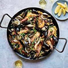 Learn to make this seafood-abundant version of classic paella, with shrimp, mussels, clams and cockles, at Food & Wine.