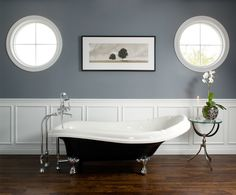 Grey walls to compliment black fixtures. Also like the use of floorboards