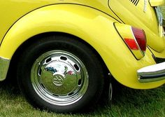 We had a beetle this color yellow with black, orange and white racing stripes!