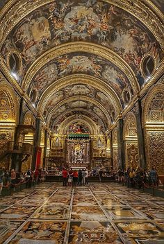 St. John's Cathedral, Valletta, Malta. It truly is over-the-top inside, but rather plain on the outside.