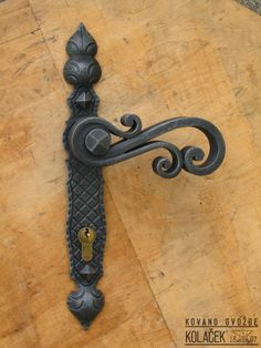 Door handle, wrought iron.  Kolacek 1897