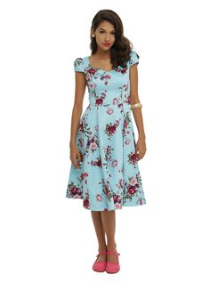 "<p>Light blue retro style dress with a pink and purple floral print, cap sleeves and sweetheart neckline. Side zipper closure.</p>  <ul> <li>41"" long from shoulder</li> <li>97% cotton; 3% spandex</li> <li>Wash cold; hang dry</li> <li>Imported</li> </ul>"