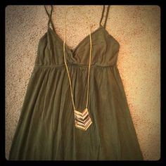 """Olive Green Maxi Dress Comfy olive green maxi dress with an elastic empire waist. 94% rayon, 6% spandex. There is wash wear (see third photo) but the dress is still very wearable! Approx 49"""" top of strap to hem. Brand is American City Wear. Dresses Maxi"""