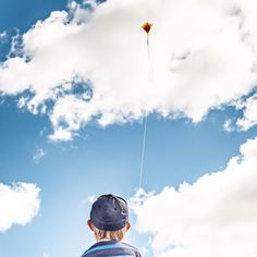 A boy is flying his kite. Kite Tattoo, Boy Tattoos, Boys Playing, Cape, Green, Instagram Posts, Family Photos, Mantle, Family Pictures
