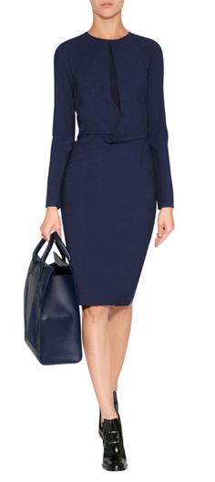 Peek-a-boo patterning lends an exquisitely modern twist to this two-tone long sleeve sheath from Vionnet #Stylebop