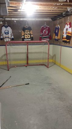 Basement transformed into an indoor hockey rink! Love it!!