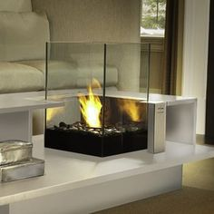 Level coffee table is the perfect furniture piece for the family room or living room. Bring the ambiance of a fireplace with ease right into your home. No mess to clean up and is clean burning. #piece #furniture #room