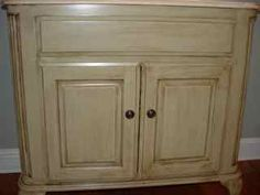 I'm really thinking of painting my cabinets & am trying to research some techniques.  This one gives a step by step to antiquing.