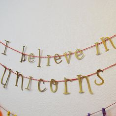 If you believe in unicorns, say it in the cutest way possible with our gorgeous banner! Approximately 6 feet long and made with beautiful gold paper, this is a great backdrop for a photobooth, or just a great wall decoration to add a pop of color to your party. #unicornparty #unicornbirthdayparty #ibelieveinunicorns #unicornbanner #ibelieveinunicornsbanner #unicornpartydecor #unicorndecoration #customparties #partyatyourdoor