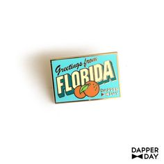 Wish you were here! New for 2016! A mini memento from our DAPPER DAY events in Florida!1 pin, Gold, cloisonne enamel, rubber pin backer. - 1.25 Designed by Jeff Granito. See DapperDay.com for info on our next event.